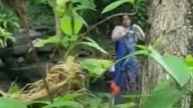 Village Lady Taking Bath Near River
