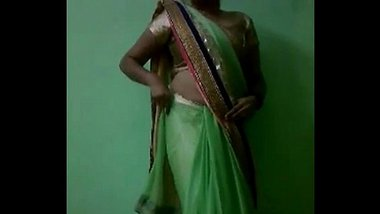 Indian Bhabhi In Sari Stripping Naked - IndianHiddenCams.com