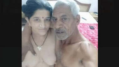 Indian old man with a young girl