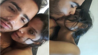 Bearded guy from India and girlfriend start morning with kissing