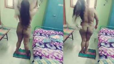 Indian BBW dries body after a shower in the hidden cam video